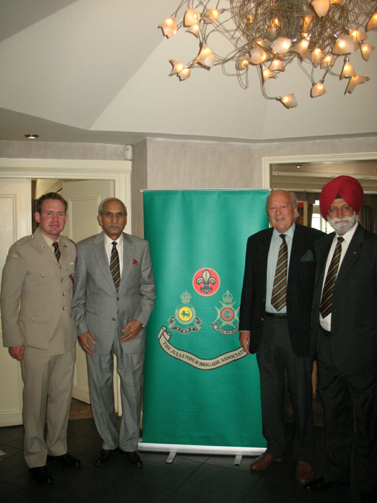 The new Association Banner was presented to the Association by the Secretary General Pushpinder Singh Chopra at the London Lunch. Flanking it from left to right are Captain Christian Wragg Escort to the Jullundur Trophy by kind permission of the Commanding Officer 2nd Battalion The Duke of Lancaster's Regiment , Major General Akram (past Colonel of the Ist Battalion (SCINDE) Frontier Force Regiment, the President and the Secretary General.