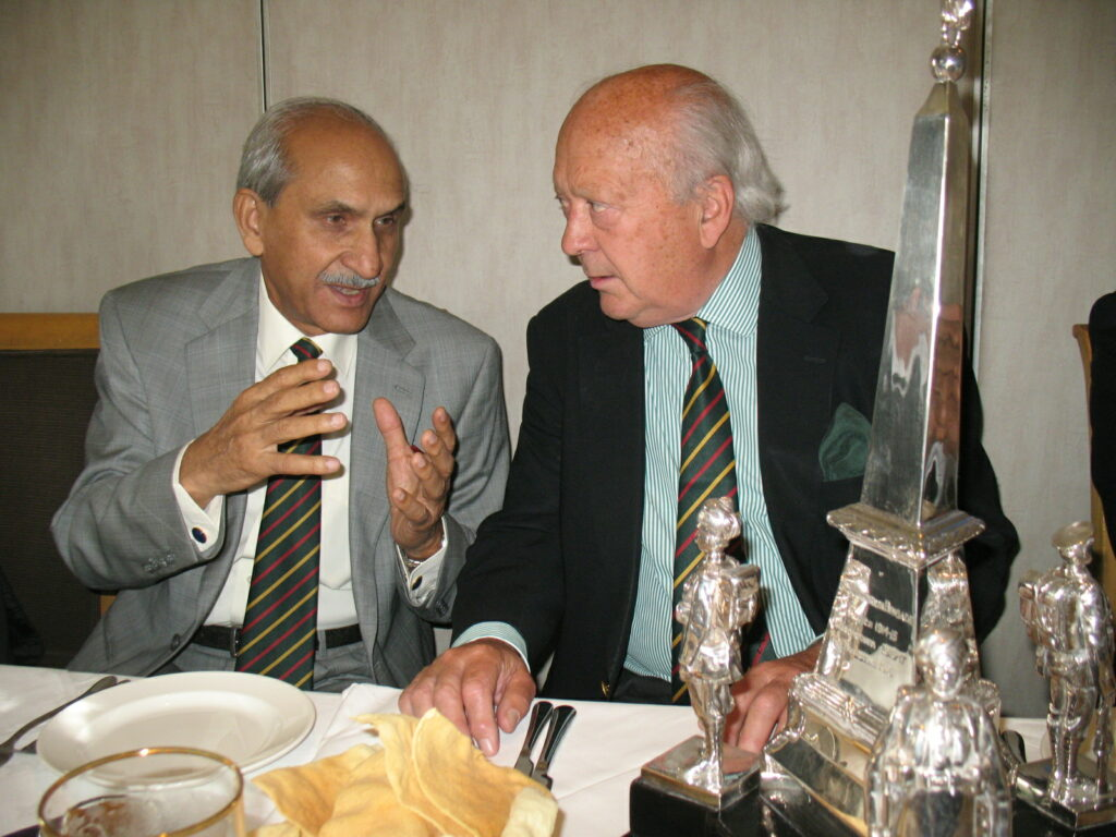 Major General Akram and Major General Davies in deep conversation in front of the Jullundur Trophy. The two Generals served as Colonels of their respective Regiments (Ist (SCINDE) Frontier Force Regiment and The King's Regiment) at the same time.